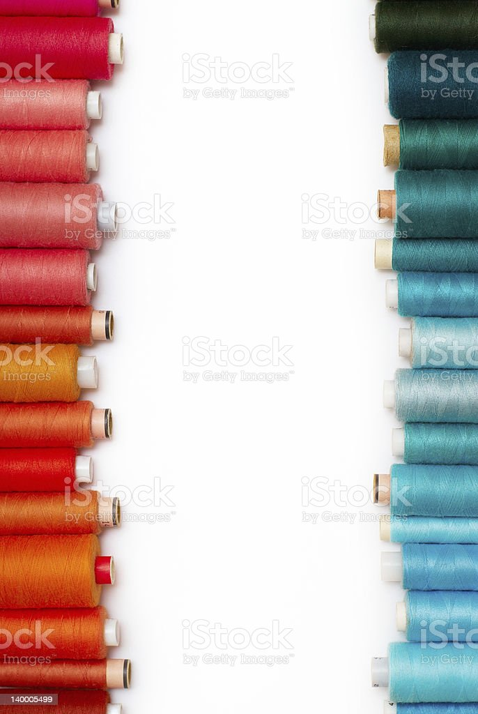 colored bobbins stock photo
