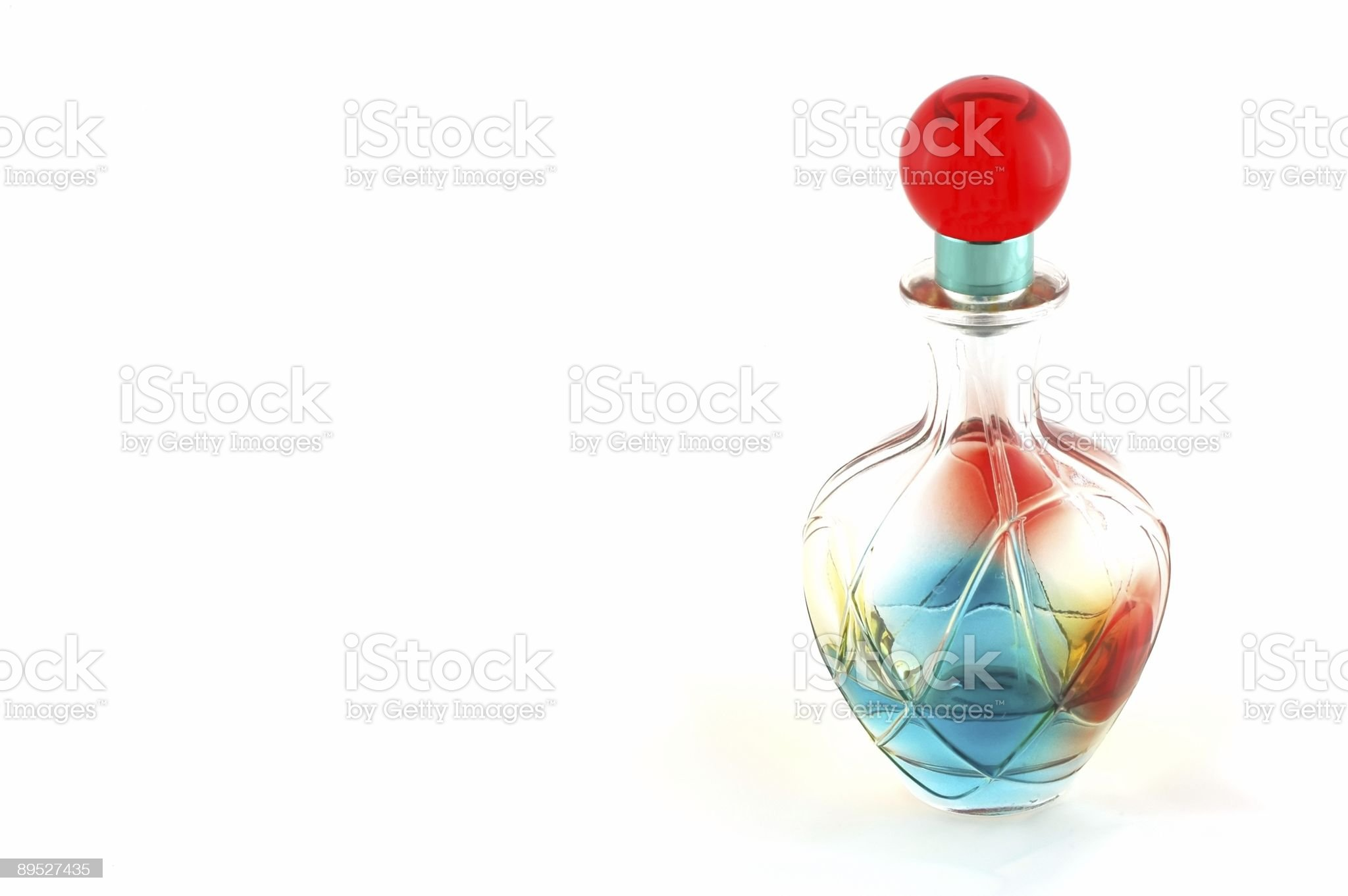 colored bottle of perfume over white background royalty-free stock photo