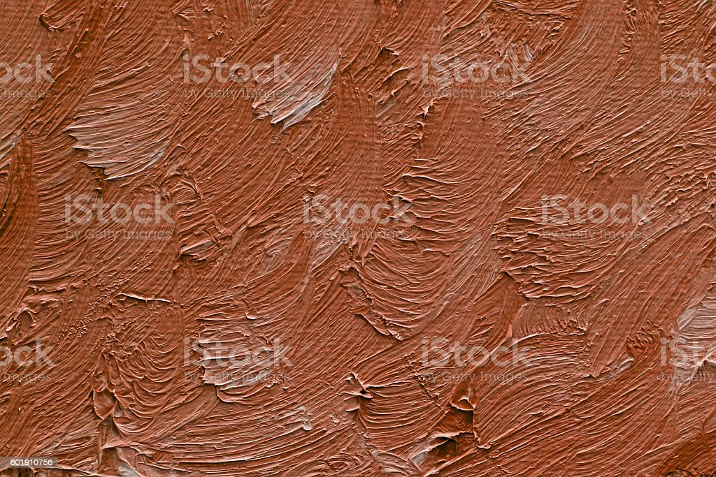 Colored brushstrokes of brown oil paint on canvas stock photo
