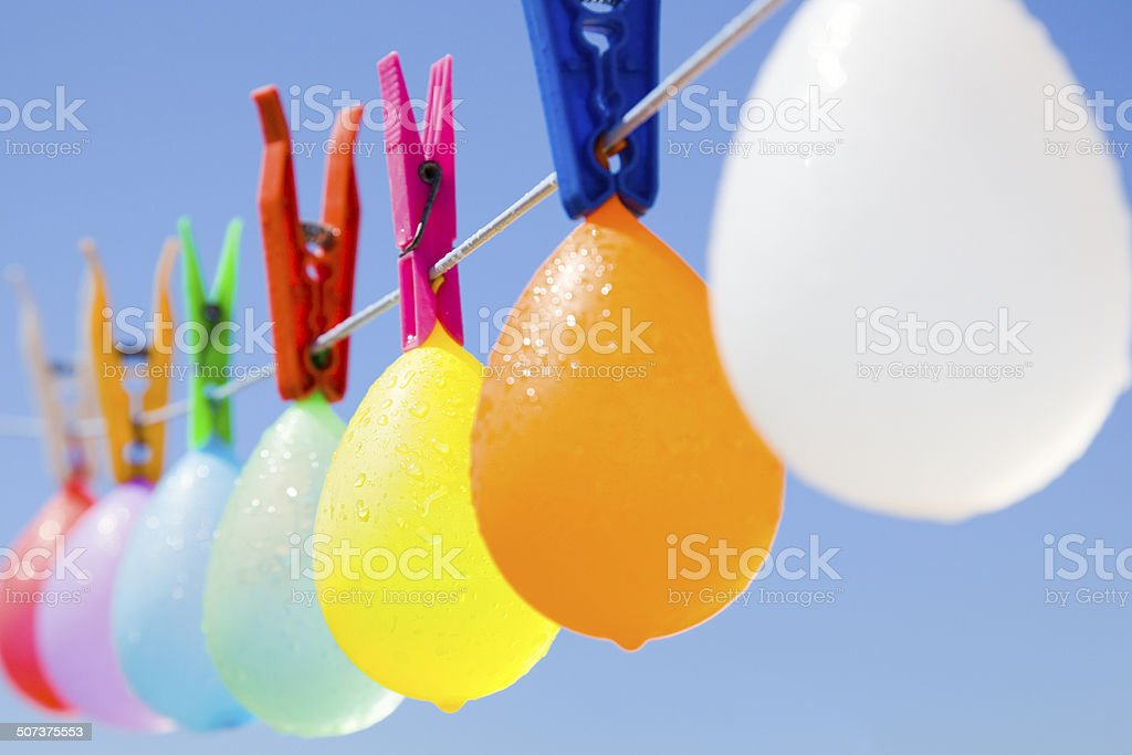 Colored bunch of cool balloons hanging on a clothesline stock photo