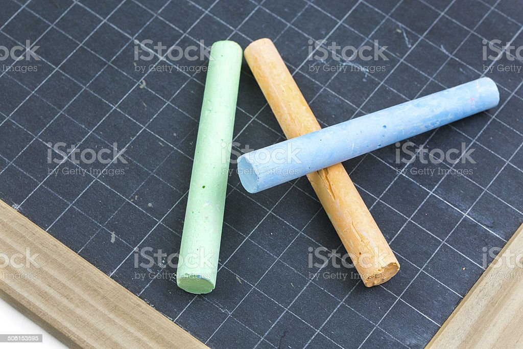 colored chalk placed on a school slate royalty-free stock photo