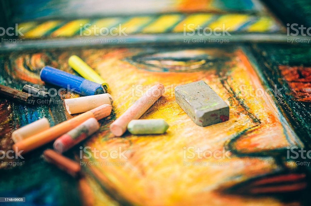 Colored chalk sticks lying on a drawing royalty-free stock photo