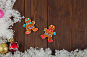Colored christmas balls and gingerbread man decoration on wood
