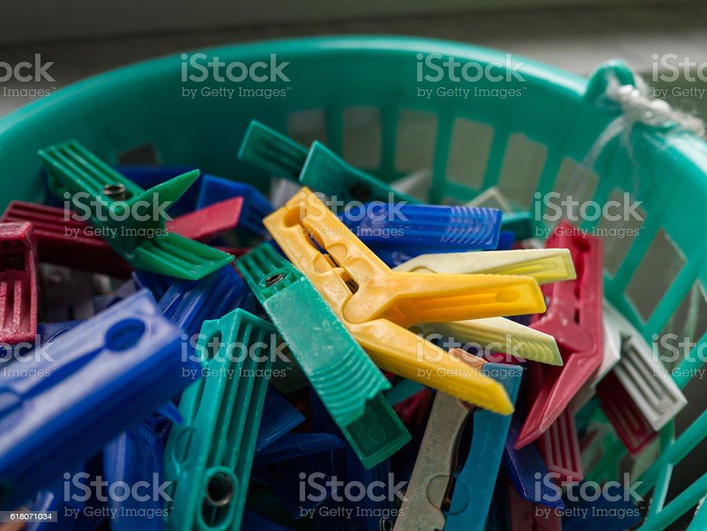 Colored Clothespin Basket Closeup stock photo