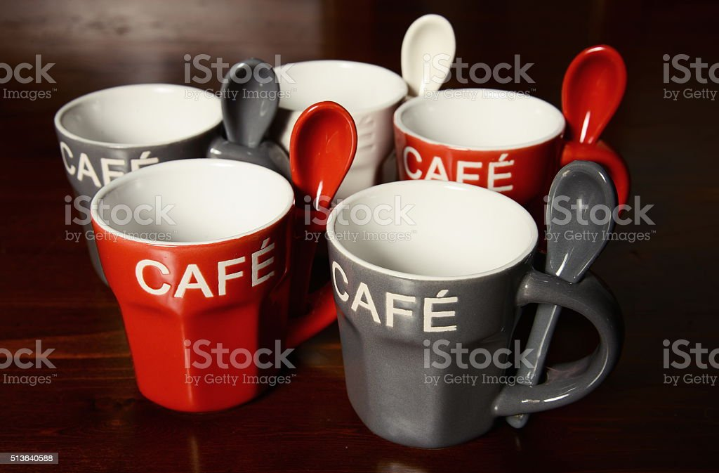 Colored Coffee cups on wooden table stock photo