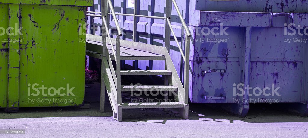 colored containers of toxic waste landfill stock photo