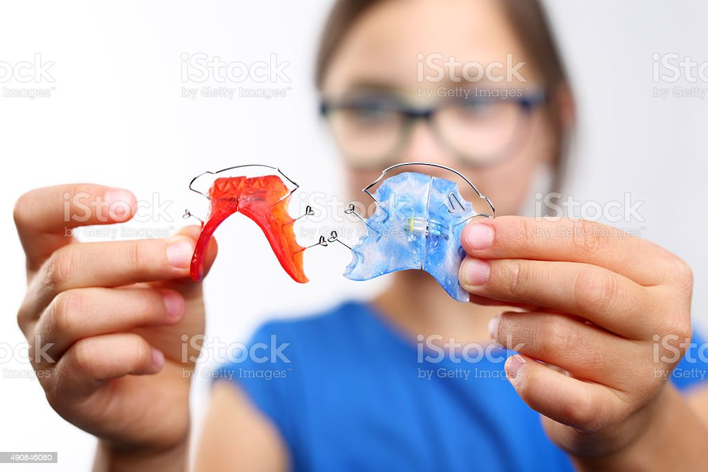 Colored dental braces stock photo