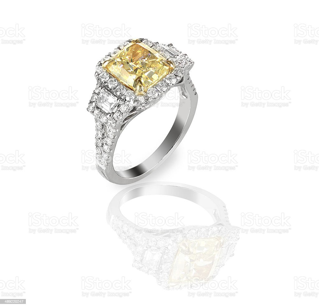 Colored diamond canary yellow in halo setting engagement wedding ring stock photo