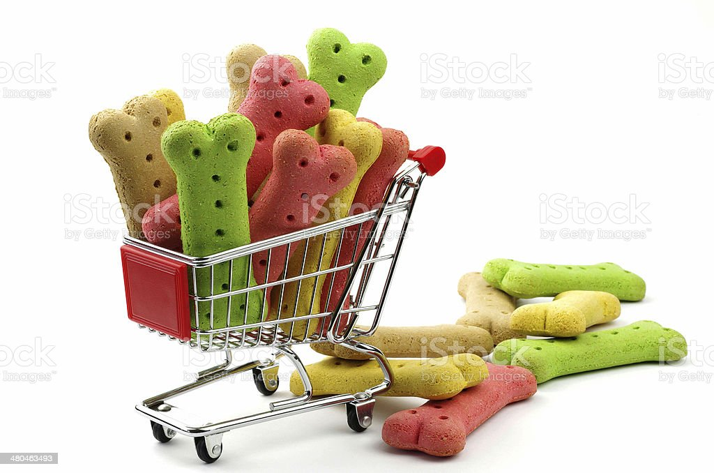 colored dog biscuits and a shopping cart stock photo