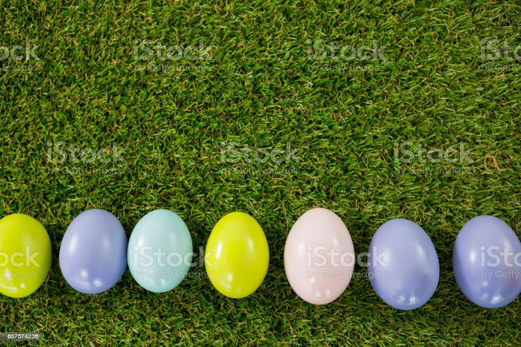 Colored Easter egg on grass stock photo