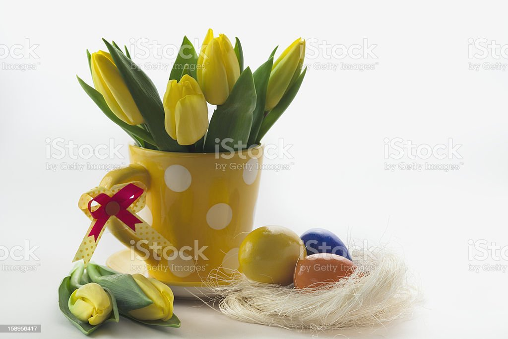 colored easter eggs and yellow Tulips royalty-free stock photo