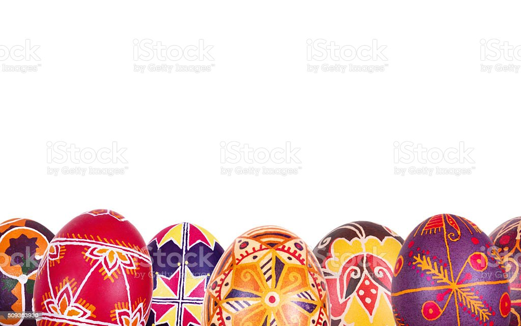 Colored Easter eggs in a row stock photo
