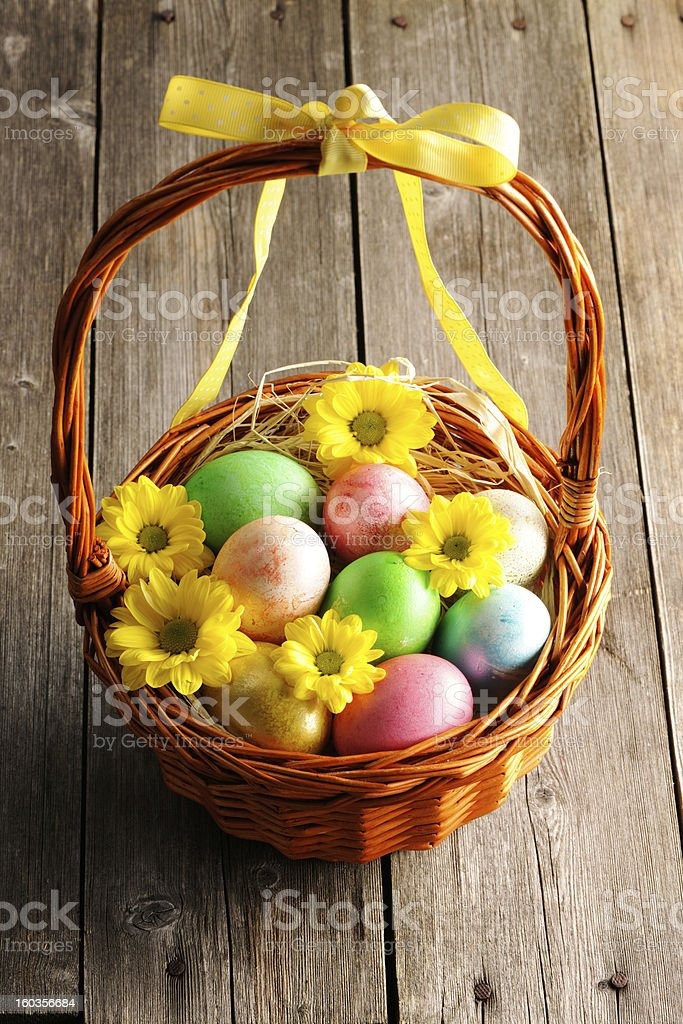 Colored easter eggs in basket royalty-free stock photo