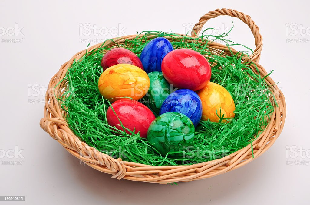 Colored Easter Eggs in Basket with Gras royalty-free stock photo
