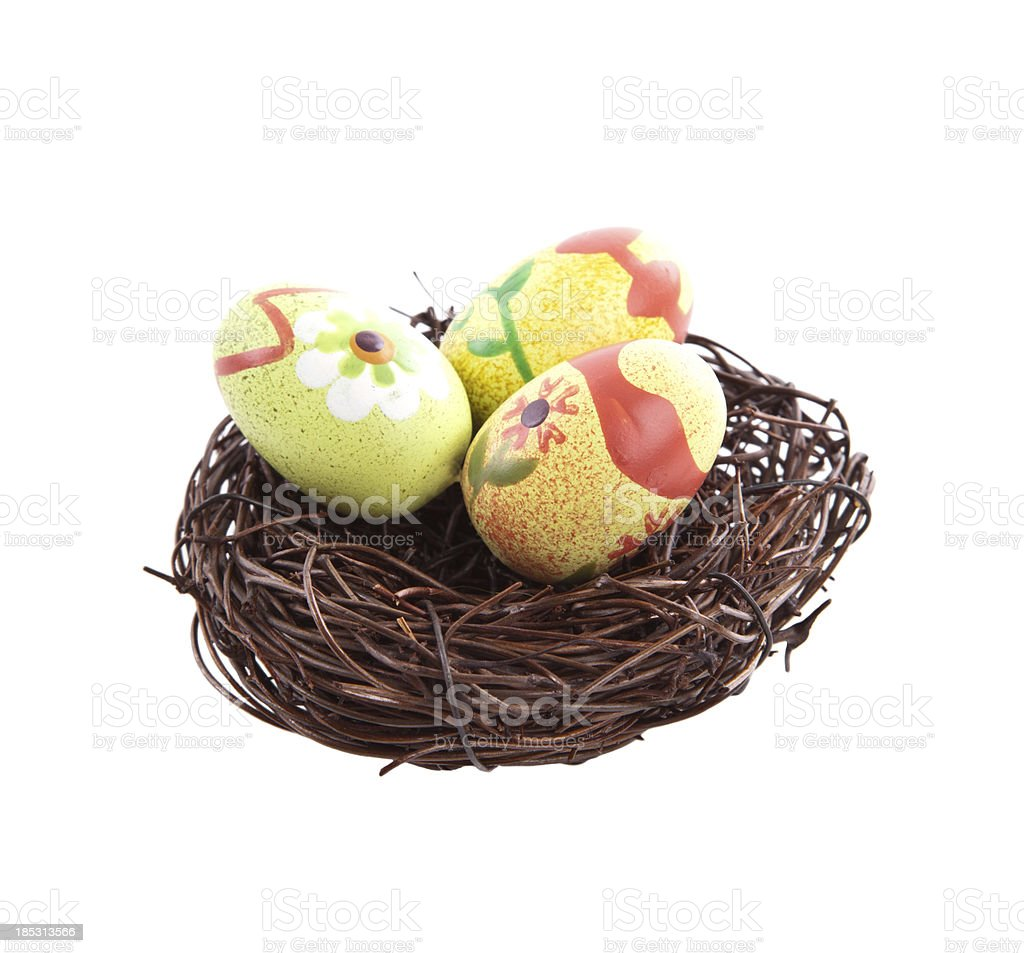 Colored easter eggs in nest royalty-free stock photo