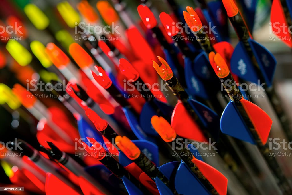 Colored feathers of modern arrows for archery stock photo
