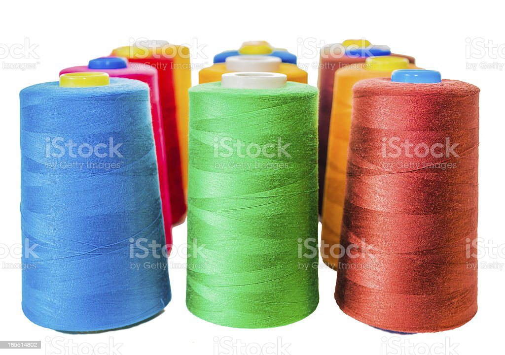 Colored fine thread bobbins royalty-free stock photo