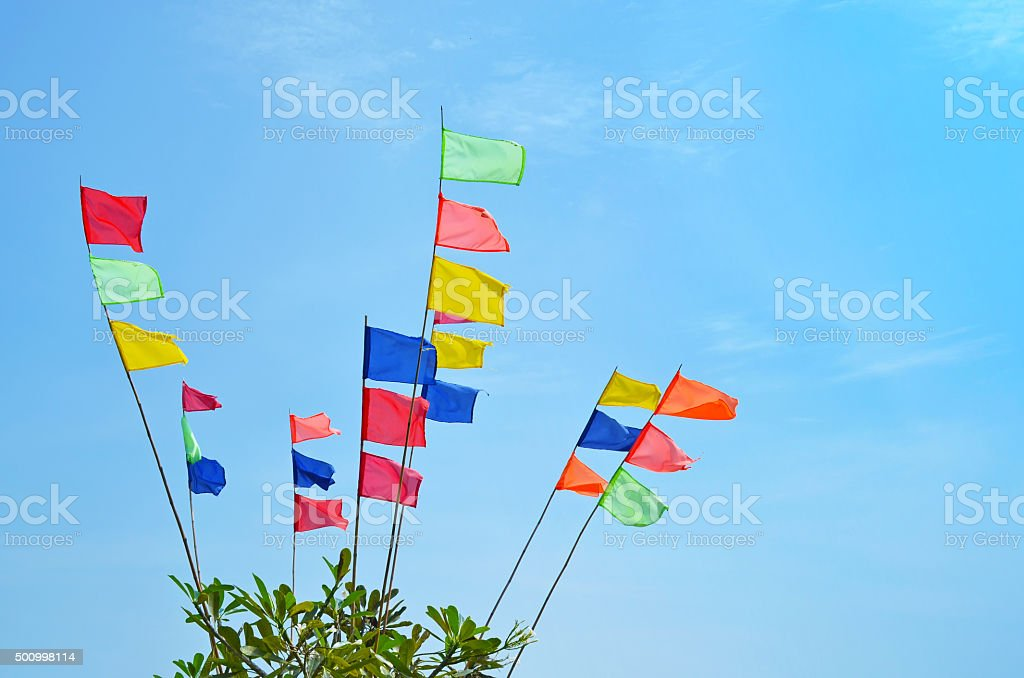 Colored flags in the wind stock photo
