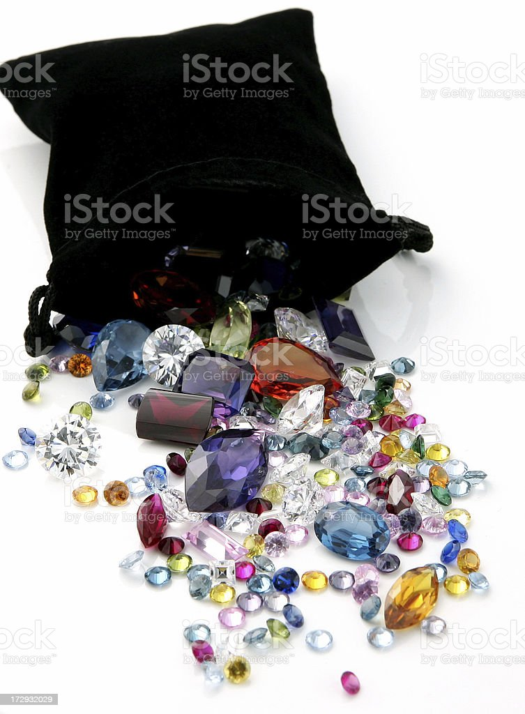 Colored Gemstones Spilling out of Black Bag stock photo