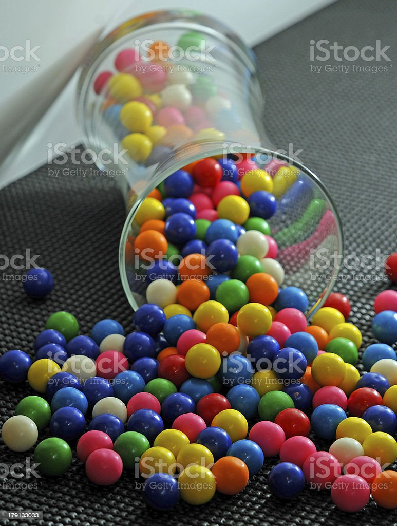 Colored Gumballs Spilling Out of a Jar royalty-free stock photo