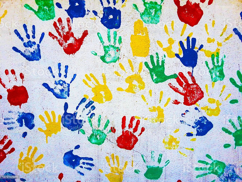 colored hand prints on white background stock photo