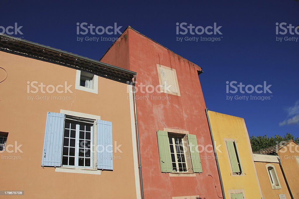 Colored houses in Roussillion, France stock photo