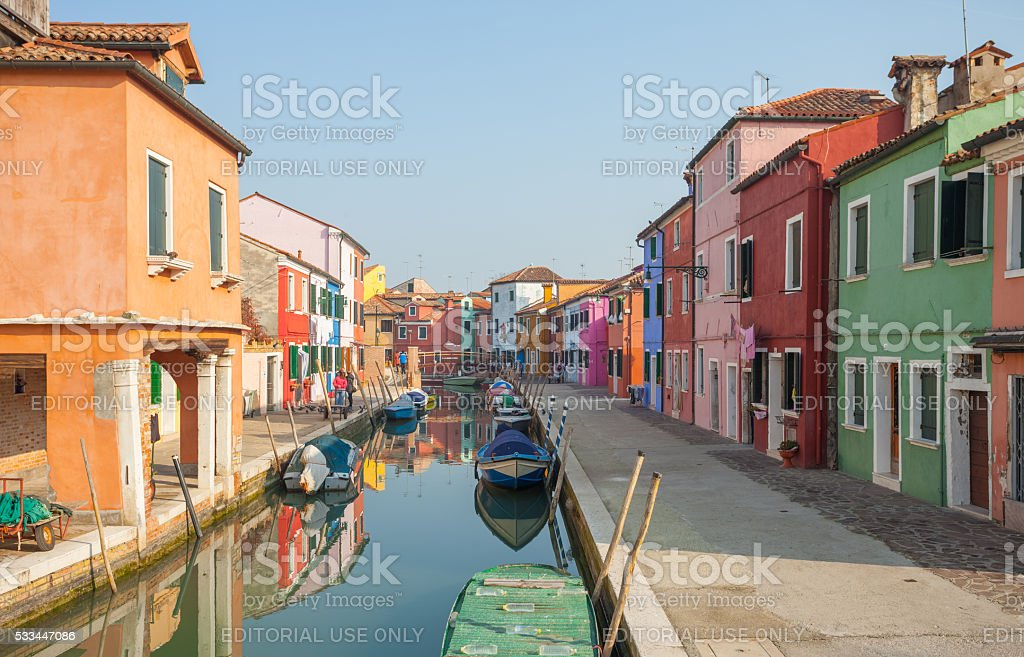 colored houses long a typical secondary canal in Burano island stock photo