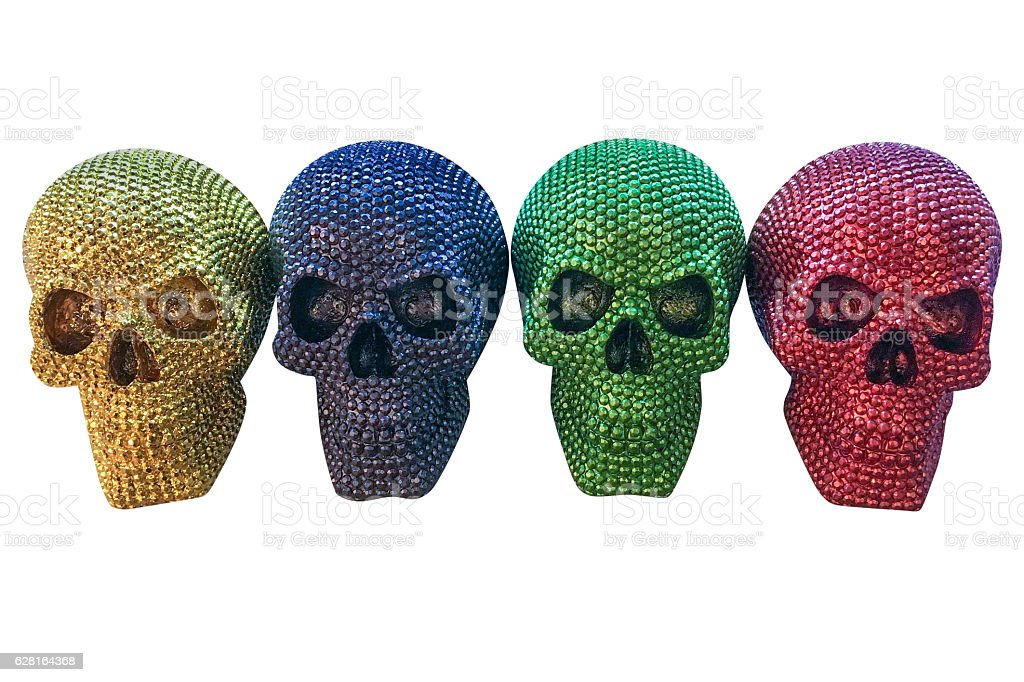 colored human skulls isolated on white background stock photo