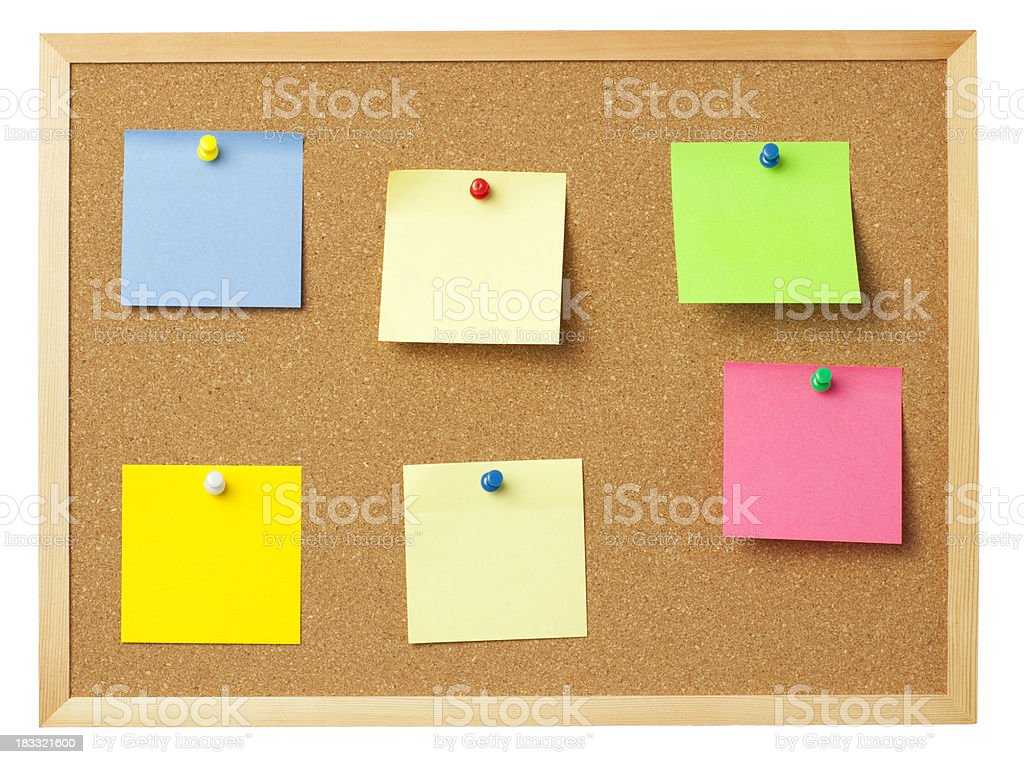 Colored info notes on cork board. royalty-free stock photo