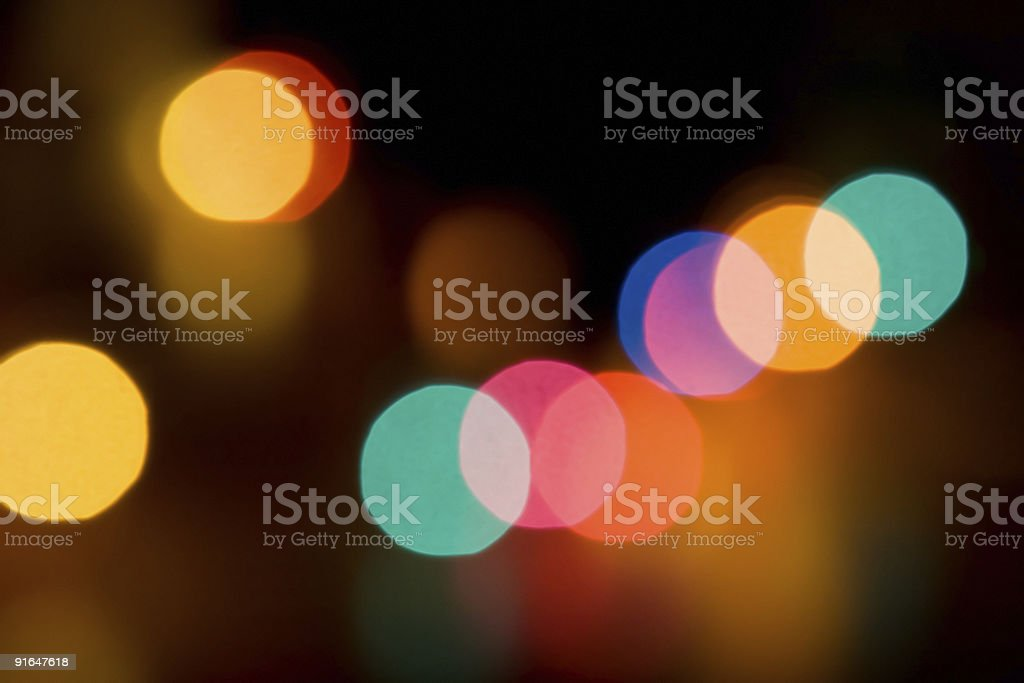 Colored Light Blurs With Soft Gold Reflections On Black royalty-free stock photo