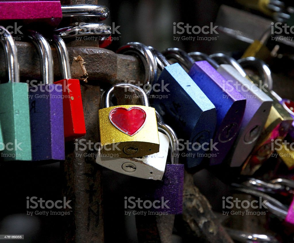 colored locks love in gate of the House of Romeo stock photo