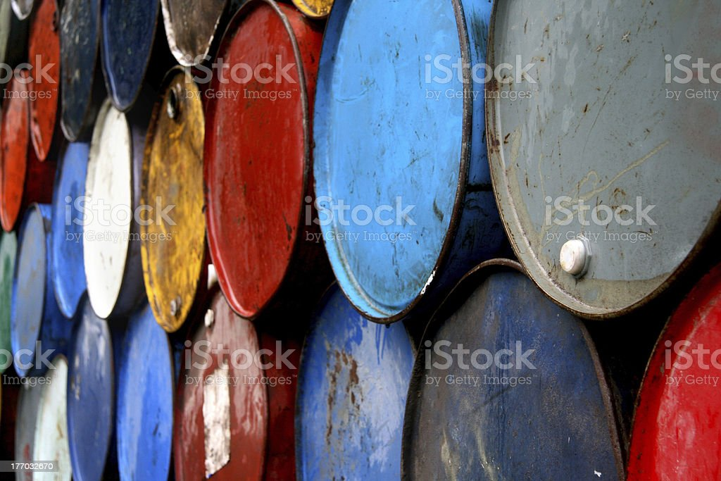 Colored oil barrels stacked on top of each other stock photo