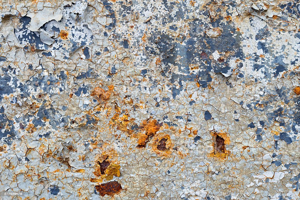 Colored paint and rust on the metal surface stock photo