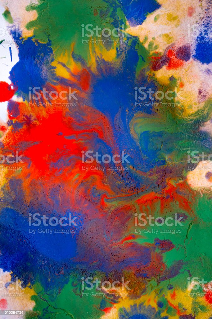 colored paint mixed on paper stock photo