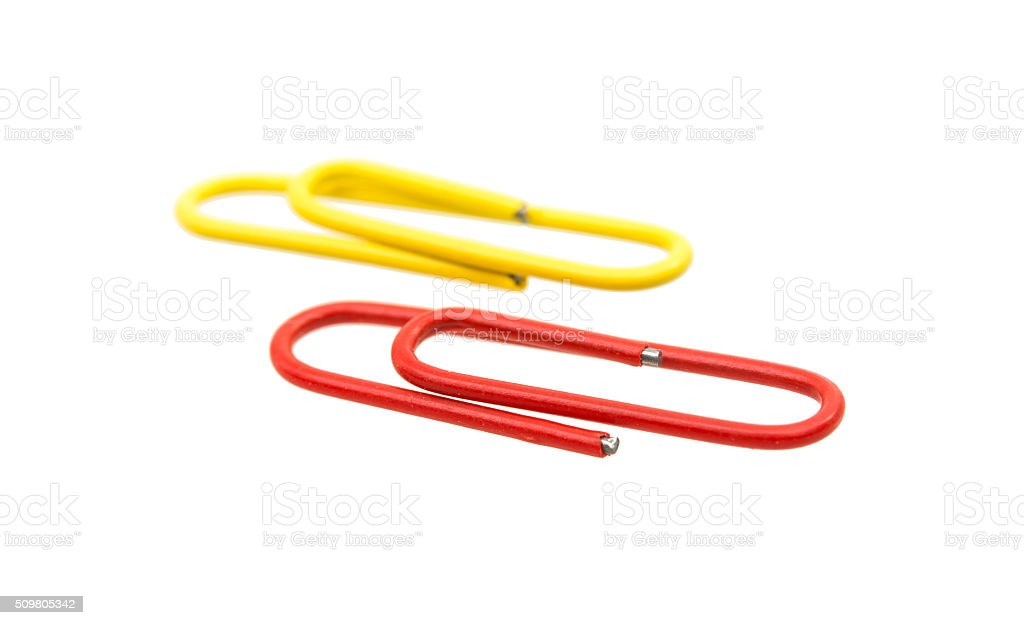 colored paper clips isolated stock photo