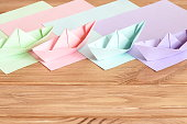 Colored paper sheets. Easy summer origami for kids