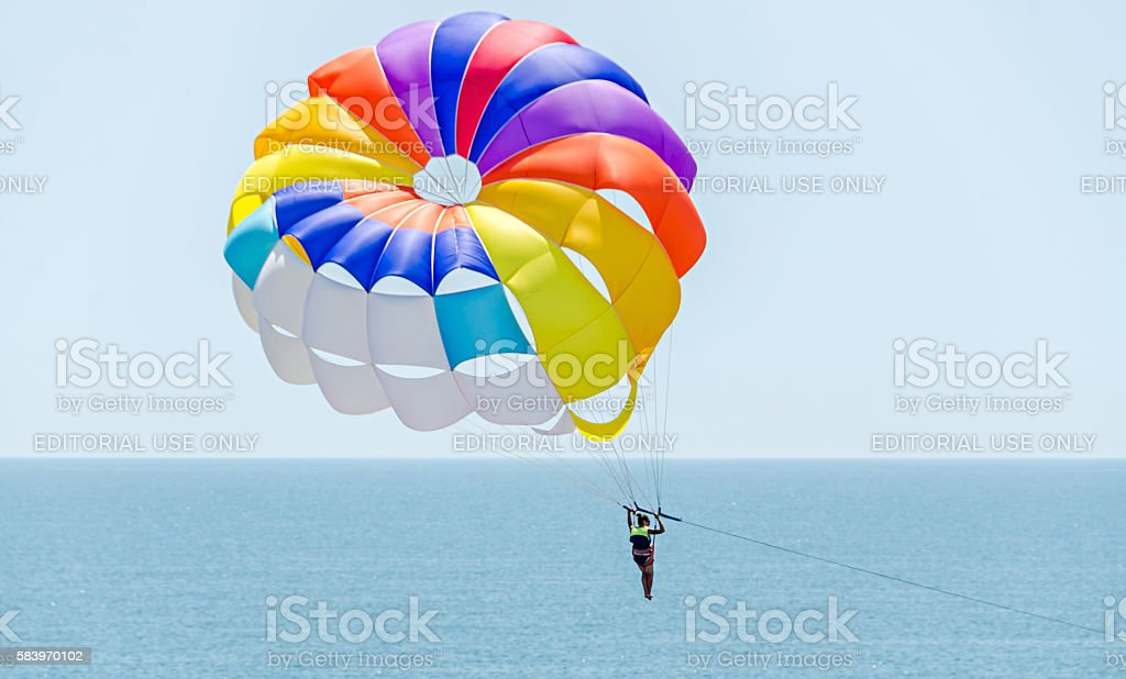 Colored parasail wing in the blue sky, Parasailing stock photo