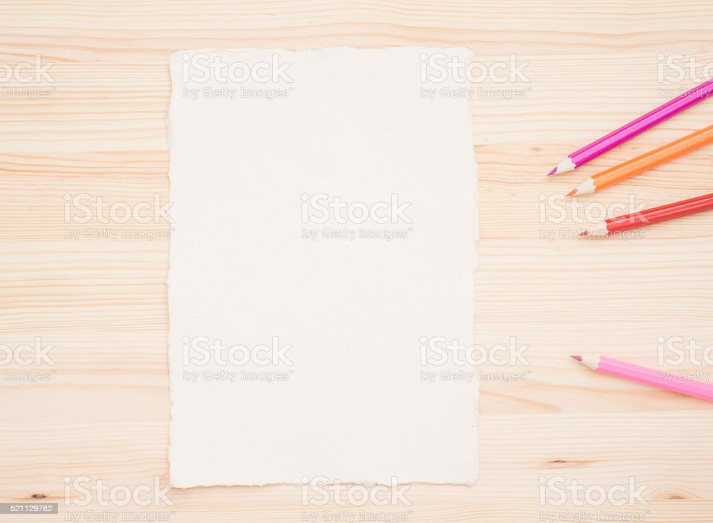 Colored pencils and drawing paper stock photo