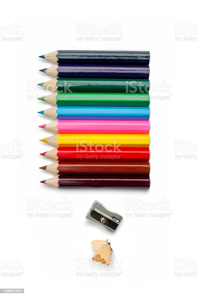 Colored pencils and pencil sharpener stock photo