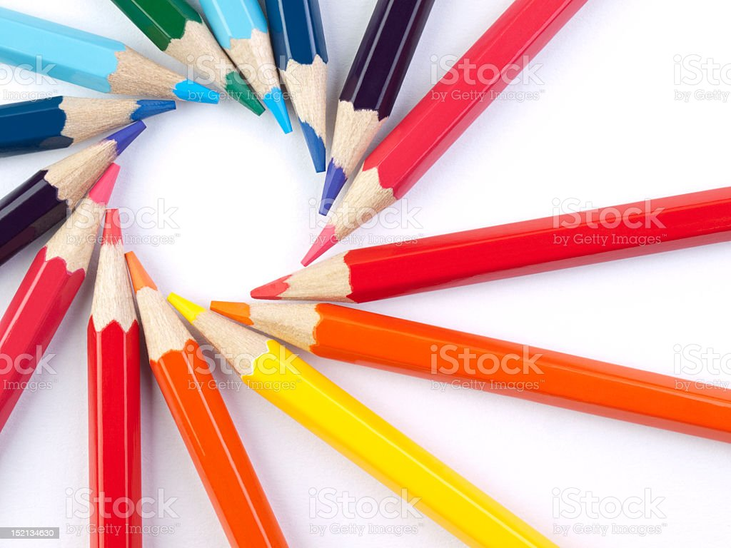 Colored pencils arranged in a circle on white background royalty-free stock photo