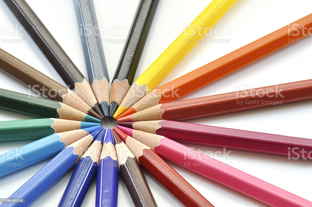 Colored pencils arranged on white background royalty-free stock photo