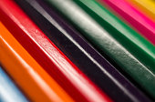 Colored pencils close-up on a white background, for backgrounds