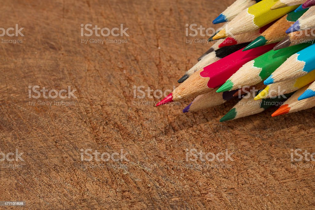 Colored Pencils, isolated on wood background royalty-free stock photo