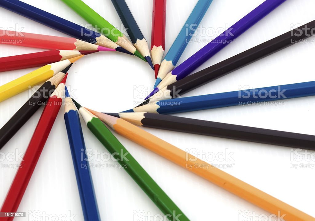 Colored pencils kept to form a circle stock photo