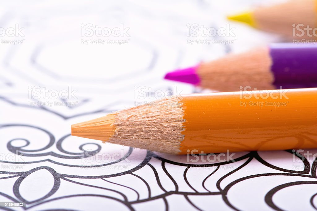 Colored Pencils on Coloring Paper stock photo