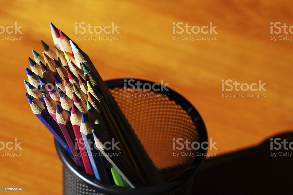 colored pencils on golden surface royalty-free stock photo