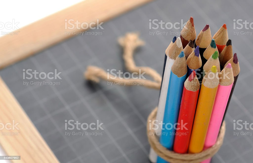 colored pencils on slate stock photo