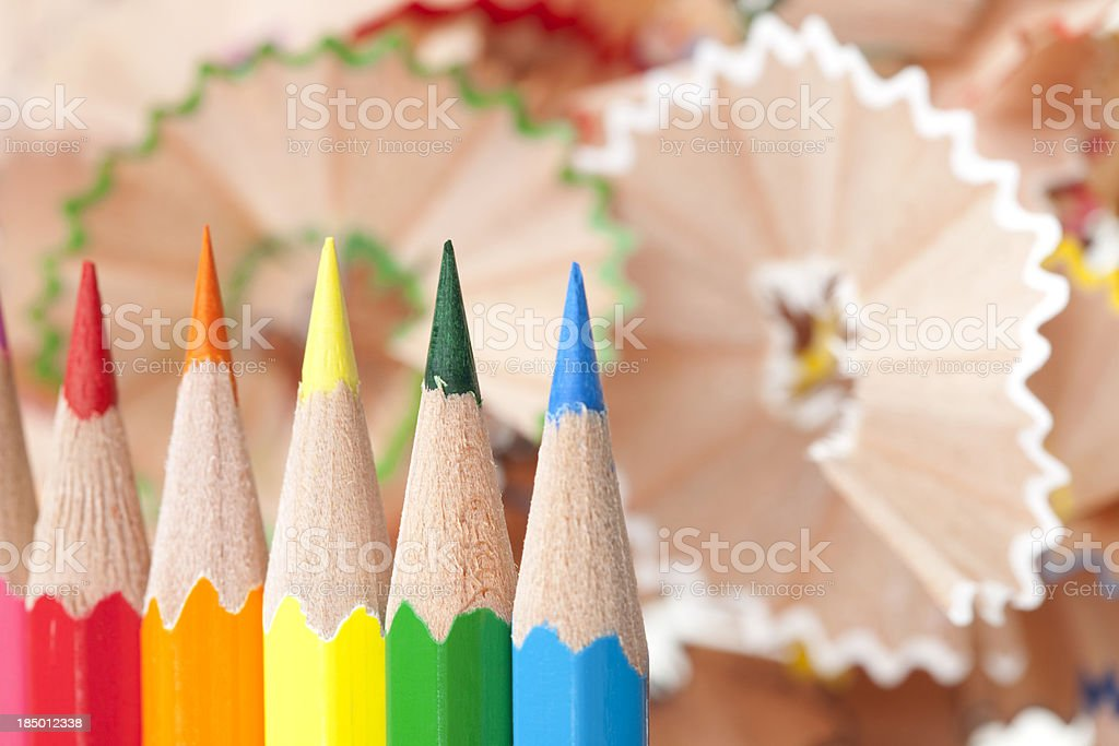 Colored pencils on wood shaving background. stock photo