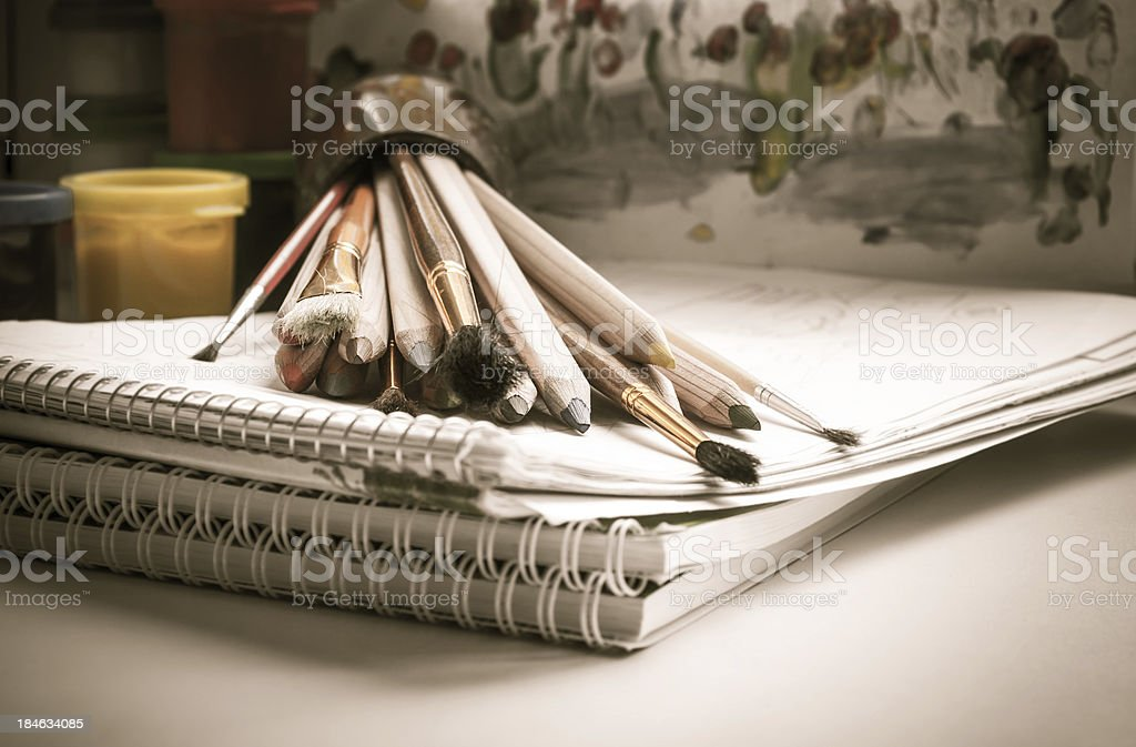 Colored pencils, paint, sketch pad, drawing, brush stock photo