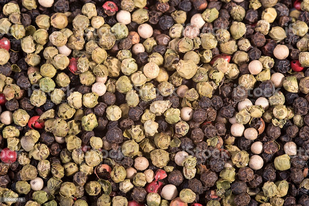 colored peppercorns as a background stock photo